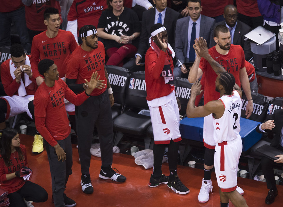 Photo -  Toronto Raptors forward Kawhi Leonard (2) celebrates with teammates after being pulled from the game against the Orlando Magic during the second half in Game 5 of a first-round NBA basketball playoff series, Tuesday, April 23, 2019 in Toronto. (Nathan Denette/Canadian Press via AP)