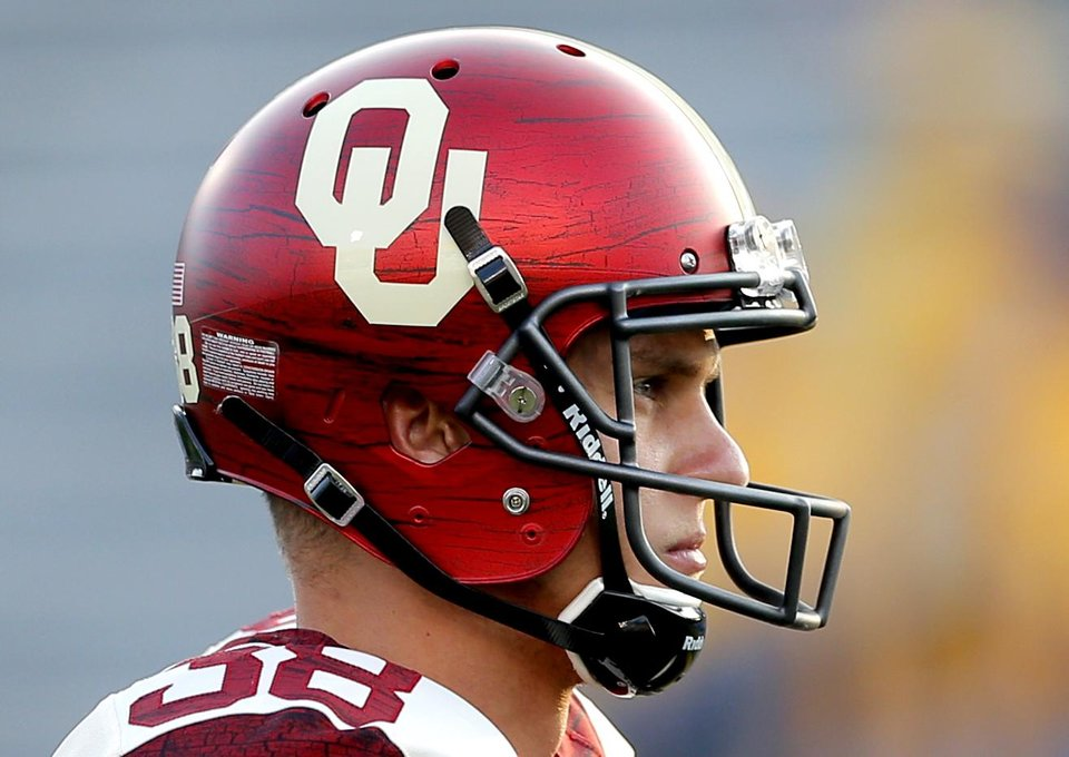 Photo - Oklahoma's Jack Steed (38) warms up during the college football game between West Virginia  Mountaineers and the University of Oklahoma Sooners at Milan Puskar Stadium in Morgantown, W.Va., Saturday, Sept. 20, 2014. Photo by Sarah Phipps, The Oklahoman