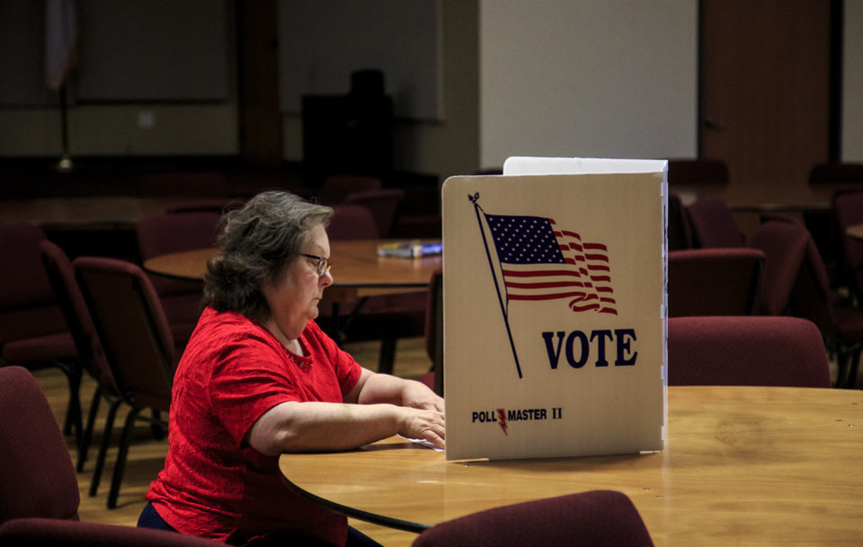 Photo - Roxie Aragon fills out her ballot on election day to cast her votes at International Pentecostal Assembly in Yukon, Okla. on Tuesday, June 26, 2018.   Photo by Chris Landsberger, The Oklahoman