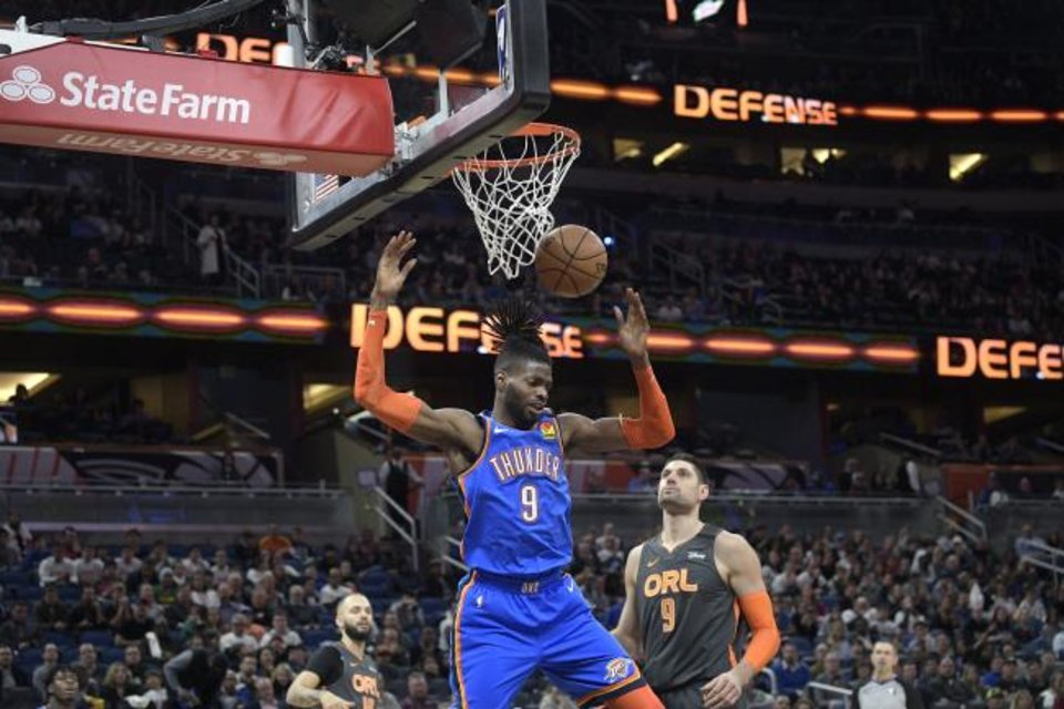 Photo -  Oklahoma City Thunder center Nerlens Noel (9) dunks the ball in front of Orlando Magic guard Evan Fournier (10) and center Nikola Vucevic (9) during the first half of an NBA basketball game Wednesday, Jan. 22, 2020, in Orlando, Fla. (AP Photo/Phelan M. Ebenhack)