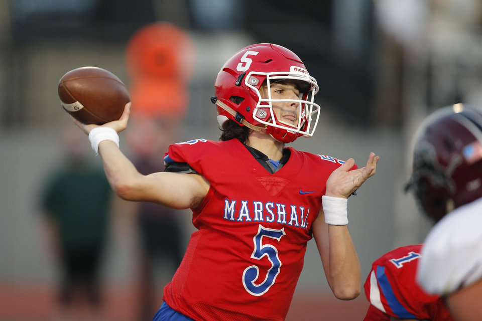 Photo - John Marshall's Kane Donovan throws a pass during a high school football game between John Marshall and Blanchard at Taft Stadium in Oklahoma City, Thursday, Sept. 24, 2020. [Bryan Terry/The Oklahoman]