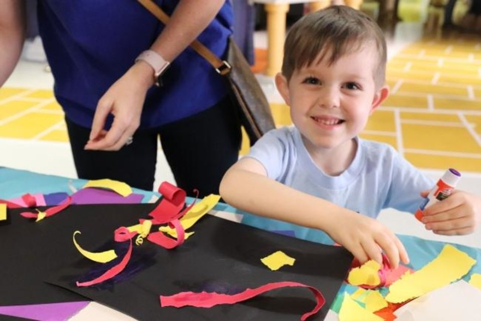 Photo -  Liam Davey, 4, shows his big smile as he works on an art project at The Children's Hospital at OU Medicine. [PHOTO PROVIDED]