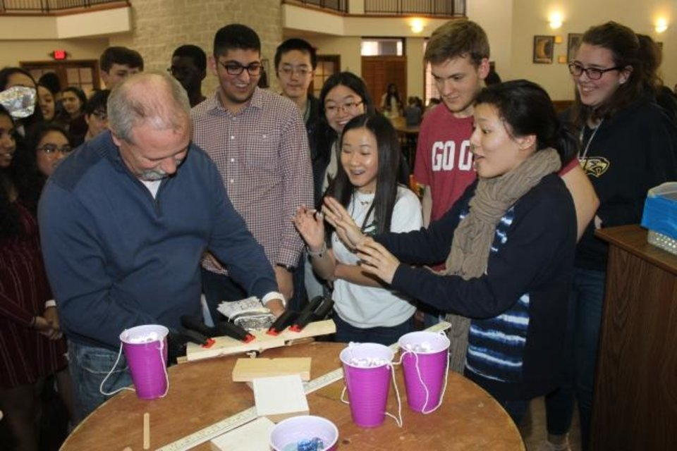 Photo -  Oklahoma School of Science and Mathematics students eagerly wait to see how much weight their wing designs will hold. [PHOTO PROVIDED]