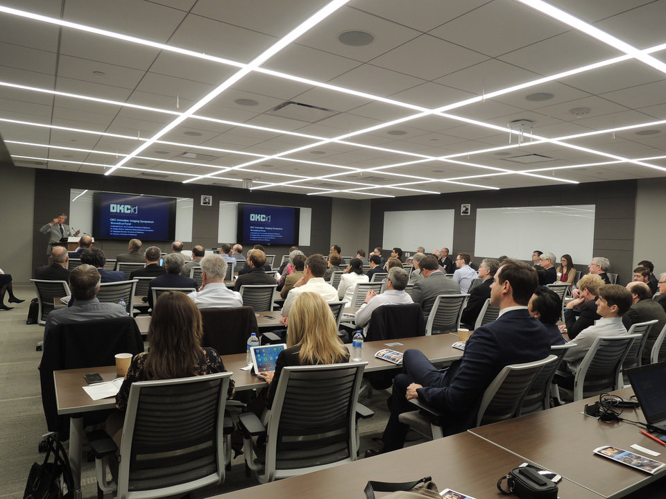Photo -  Nearly 100 area scientists and business leaders gathered Tuesday at the Oklahoma City GE Global Research Oil and Gas Technology Center for a symposium on the use of imaging technologies in the biomedical, aerospace and energy sectors. [Photo provided]