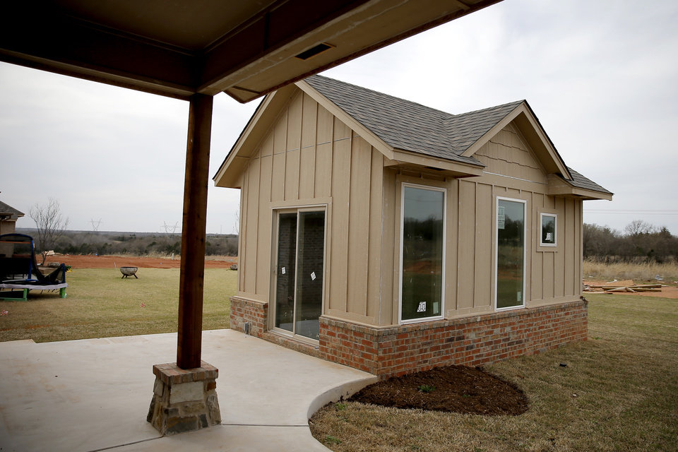 Photo -  Alder Fine Homes included a small cottage, about 200 square feet, with the home at 7001 Timber Crest Way in Edmond, an entry in Parade of Homes Spring Festival in May. [PHOTO BY BRYAN TERRY, THE OKLAHOMAN ARCHIVES]