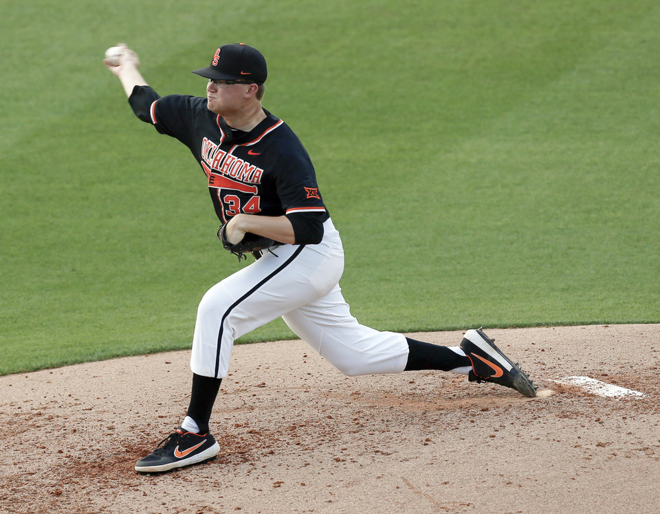 Photo - OSU's Jensen Elliott (34) pitches during a college baseball game between Baylor and Oklahoma State in the last regular-season series at Allie P. Reynolds Stadium in Stillwater, Okla., Friday, May 17, 2019. [Nate Billings/The Oklahoman]