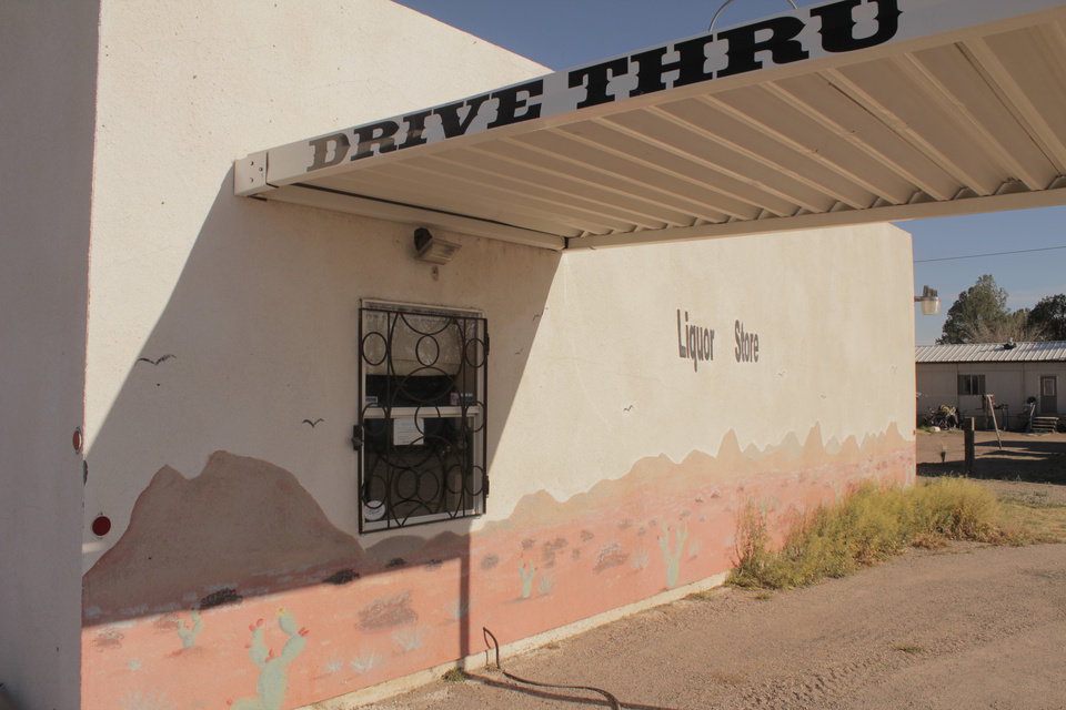 Photo -  A drive-through liquor store is seen on Sunday March 13, 2016 in Marfa, Texas. [Photo by Matt Carney, for LOOKatOKC]