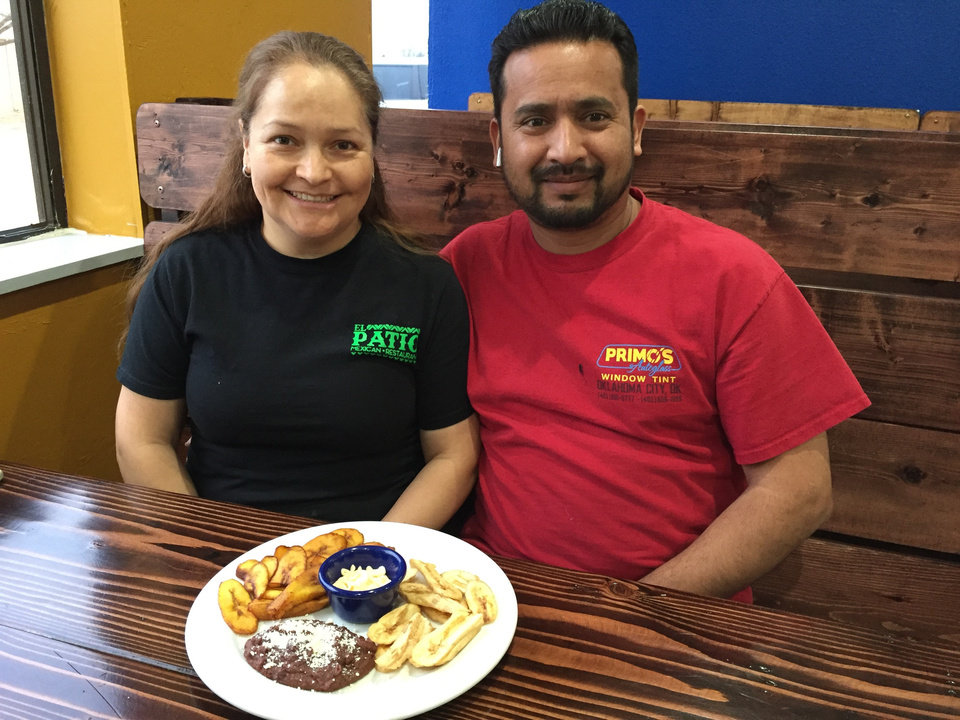 Photo - Gustavo and Marisela Rivera, owners of El Patio Mexican Restaurant at 12000 N. Interstate 35 Service Rd., are pictured with one of their restaurant's featured appetizers: fried beans, plantains and green banana chips. [JESSICA ERICKSON]