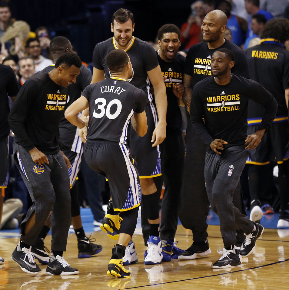 Photo - Stephen Curry (30) and the Golden State Warriors celebrate after Curry hit the game-winning shot with 0.6 seconds left in overtime during an NBA basketball game between the Oklahoma City Thunder and the Golden State Warriors at Chesapeake Energy Arena in Oklahoma City, Saturday, Feb. 27, 2016. Golden State won 121-118 in overtime. Photo by Nate Billings, The Oklahoman