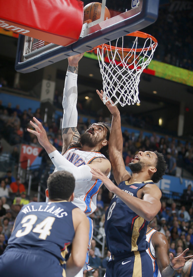 Photo - Oklahoma City's Steven Adams (12) shoots a basket beside New Orleans' Jahlil Okafor (8) during an NBA basketball game between the Oklahoma City Thunder and the New Orleans Pelicans at Chesapeake Energy Arena in Oklahoma City, Thursday, Jan. 24, 2019. Photo by Bryan Terry, The Oklahoman