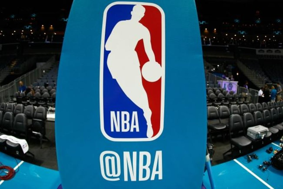 Photo -  Oct 11, 2017; Charlotte, NC, USA; A general view of the NBA logo on the stanchion prior to the game between the Charlotte Hornets and the Boston Celtics at Spectrum Center. Mandatory Credit: Jeremy Brevard-USA TODAY Sports
