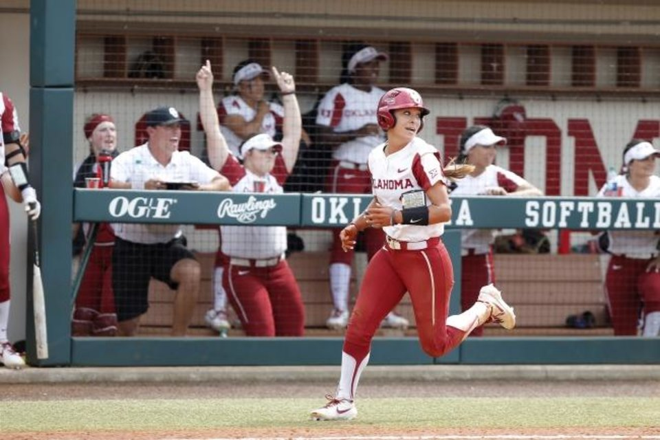Photo -  Oklahoma's Sydney Romero scores a run in the fifth inning of the Sooners' 3-0 win Friday in Game 1 of a Super Regional against Northwestern at Marita Hynes Field. [Bryan Terry/The Oklahoman]