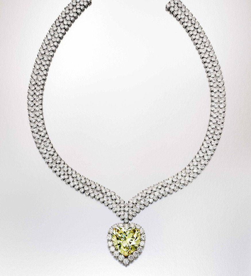 Photo - This undated photo provided by Sotheby's shows a heart-shape yellow diamond that once belonged to the Duchess of Windsor, who wore it in a ring before it was made into this necklace. It is among a trove of jewels from the collections of Estee and Evelyn Lauder that will be auctioned to benefit breast cancer research on Dec. 5. AP Photo/Sotheby's   - AP