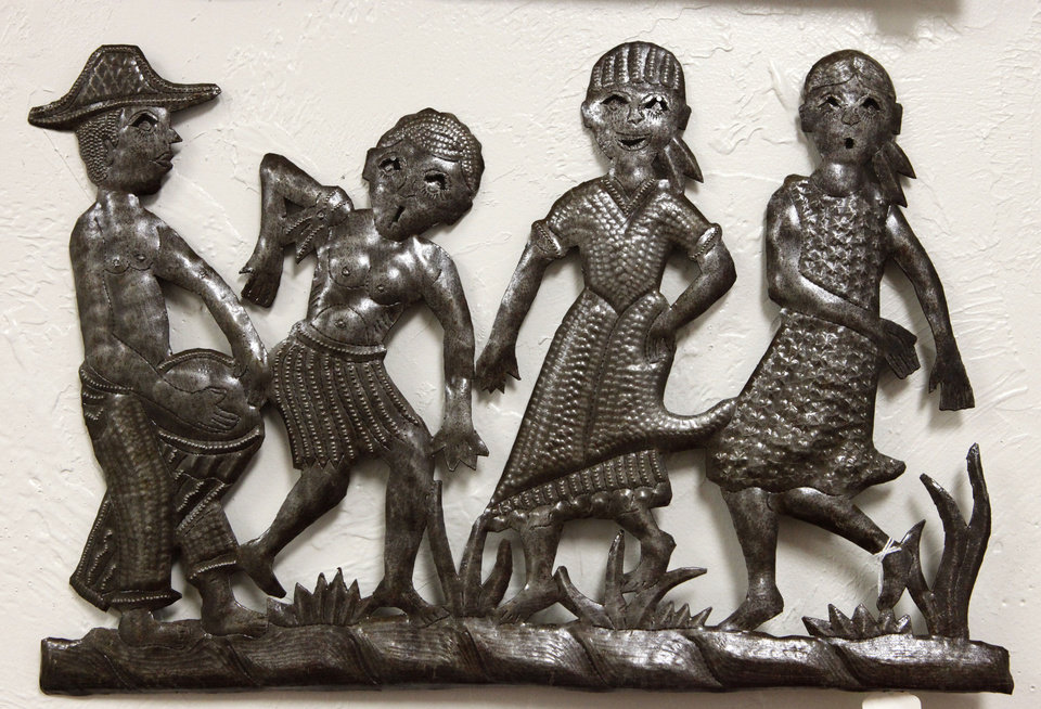 Photo - This metal wall hanging from Haiti is one of the items for sale at  Pambe Ghana Global Market. Photo By David McDaniel, The Oklahoman.  David McDaniel - The Oklahoman