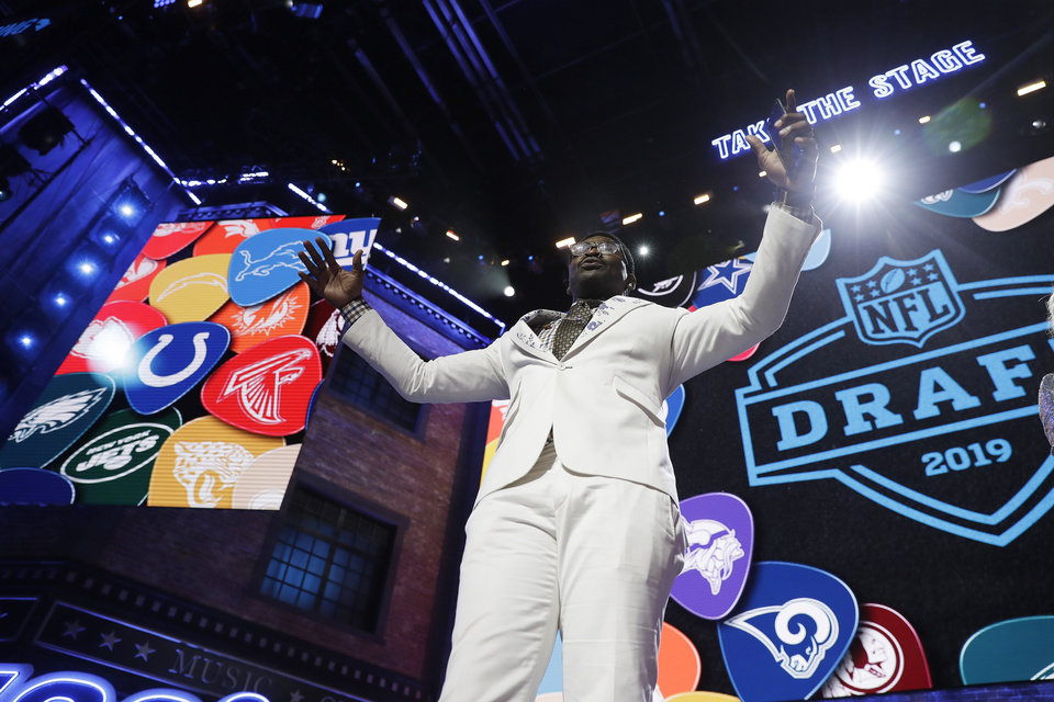Photo - Former Dallas Cowboys player Michael Irvin speaks to the crowd ahead of the first round at the NFL football draft, Thursday, April 25, 2019, in Nashville, Tenn. (AP Photo/Mark Humphrey)