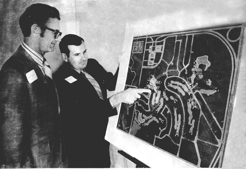 Photo - Tom Morris, left, and Don Sechrest look over plans for a new golf and residential layout. Staff photo from Oklahoman Archive.