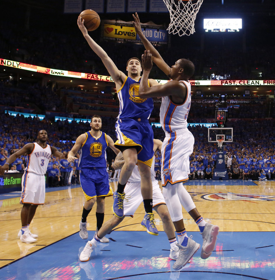 Photo - Golden State's Klay Thompson (11) goes to the basket past Oklahoma City's Kevin Durant (35) during Game 6 of the Western Conference finals in the NBA playoffs between the Oklahoma City Thunder and the Golden State Warriors at Chesapeake Energy Arena in Oklahoma City, Saturday, May 28, 2016. Photo by Bryan Terry, The Oklahoman