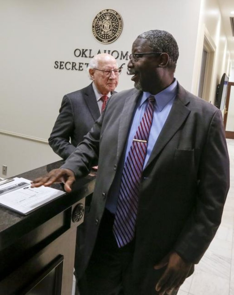 Photo -  Rev. Theodis R. Manning Sr., front, and Gene Rainbolt with Oklahomans for Sentencing Reform leave the Oklahoma Secretary of State's office after filing a constitutional ballot initiative Tuesday at the state Capitol. The initiative would end some sentence enhancements for nonviolent offenses and allow people who are currently serving those sentences to petition for relief. [Nate Billings/The Oklahoman]