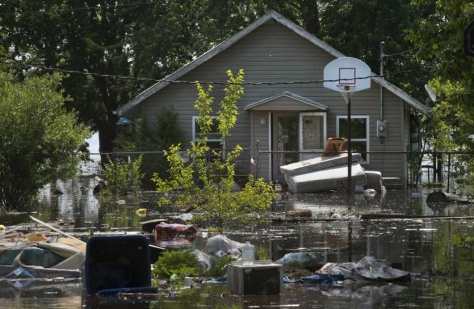 Photo - After residents emptied mattresses and other furnishings from a previously flooded Foley home, Mississippi River flood water rises again in Lincoln County for a scheduled third crest next week on Friday, May 24, 2019. (Robert Cohen/St. Louis Post-Dispatch via AP)
