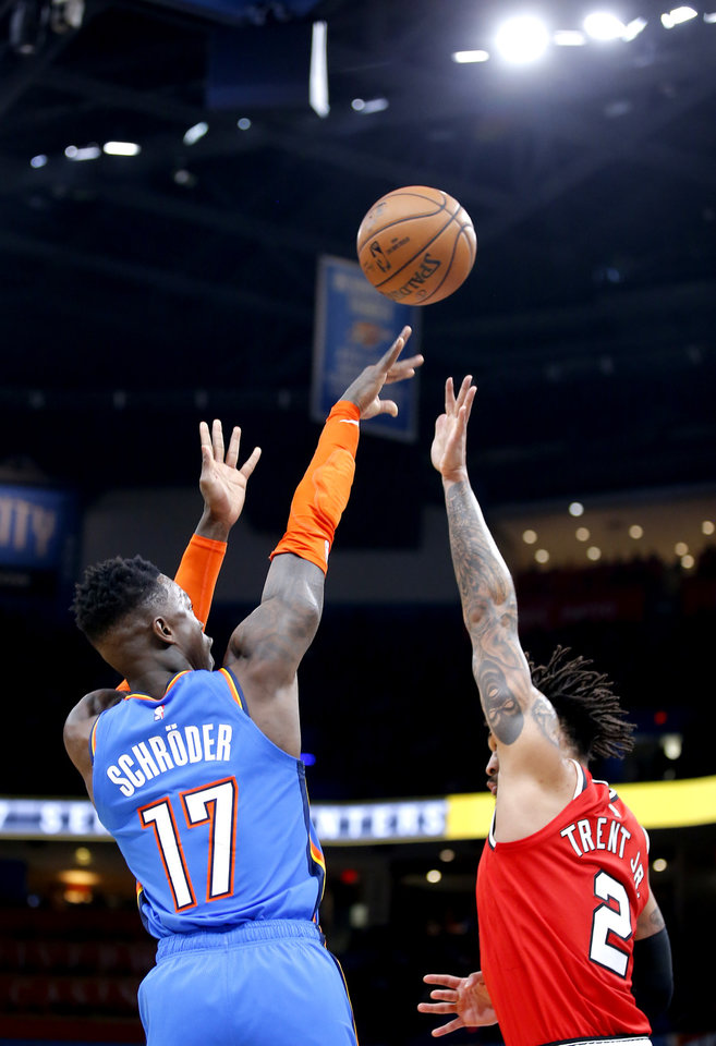 Photo - Oklahoma City's Dennis Schroder (17) shoots as Portland's Gary Trent Jr. (2) defends during the NBA basketball game between the Oklahoma City Thunder and the Portland Trail Blazers at the Chesapeake Energy Arena in Oklahoma City, Saturday, Jan. 18, 2020.  [Sarah Phipps/The Oklahoman]