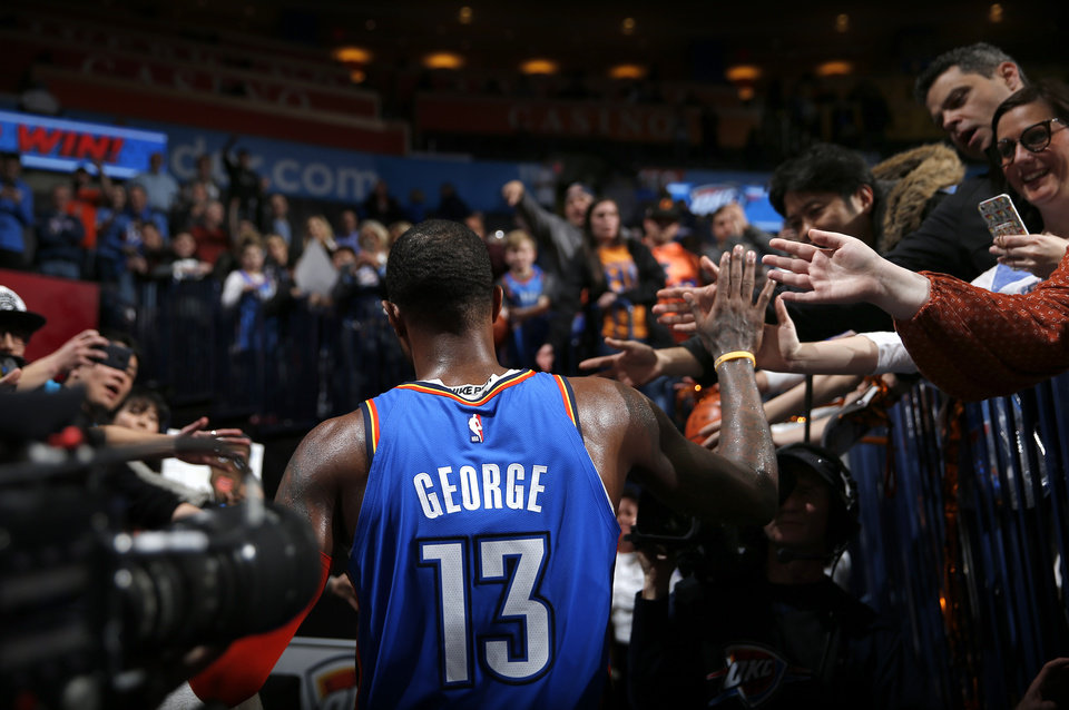 Photo - Oklahoma City's Paul George (13) greets fans following the NBA game between the Oklahoma City Thunder and the Utah Jazz at the Chesapeake Energy Arena, Saturday, Feb. 23, 2019. Photo by Sarah Phipps, The Oklahoman