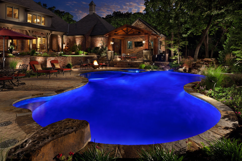 Pool design features to add to your backyard oasis without for Pool design okc