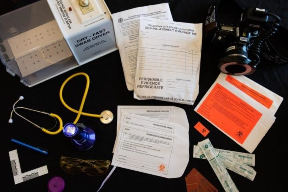 Photo -  Materials from a Sexual Assault Nurse Examiner kit are spread out on a table at the YWCA in Oklahoma City. Swabs, photos, measurements and victim accounts of an incident are all part of the evidence collected by the specially trained nurses. [Whitney Bryen/Oklahoma Watch]