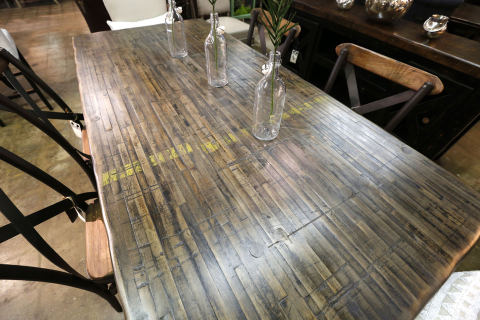 Photo -  This table at Urban Farmhouse is made from reclaimed wood from old train cars.    PAUL HELLSTERN -  Oklahoman