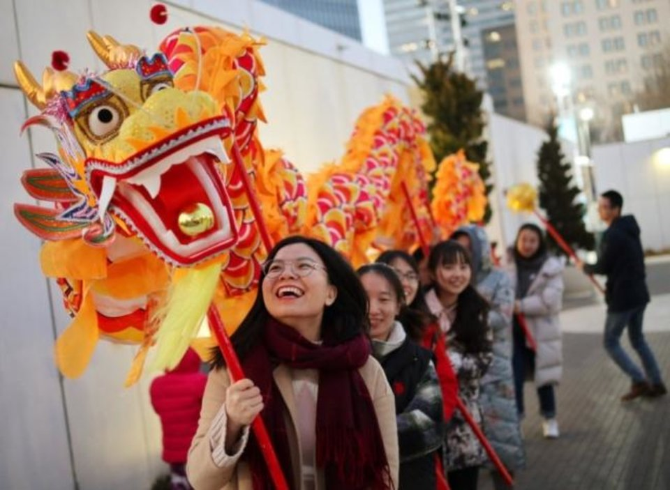 Photo -  Lurou Tu, with the University of Oklahoma Confucius Institute, prepares to lead her group in a dragon dance demonstration Feb. 8, 2019, during a Lunar New Year celebration at the Myriad Botanical Gardens. [Doug Hoke/The Oklahoman Archives]