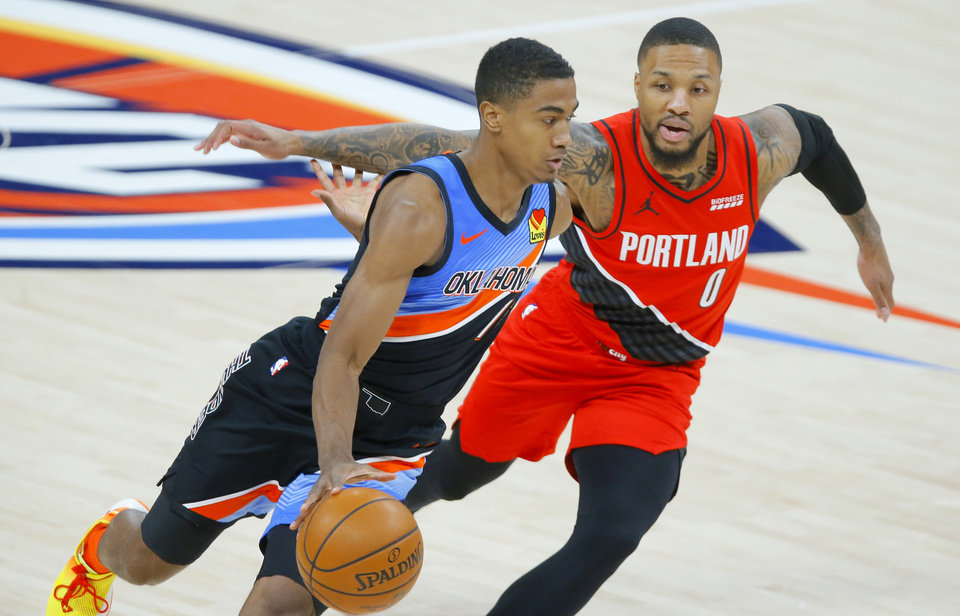Photo - Theo Maledon (11) goes ast Portland's Damian Lillard (0) during an NBA basketball game between the Oklahoma City Thunder and the Portland Trail Blazers at Chesapeake Energy Arena in Oklahoma City, Tuesday, Feb. 16, 2021. [Bryan Terry/The Oklahoman]