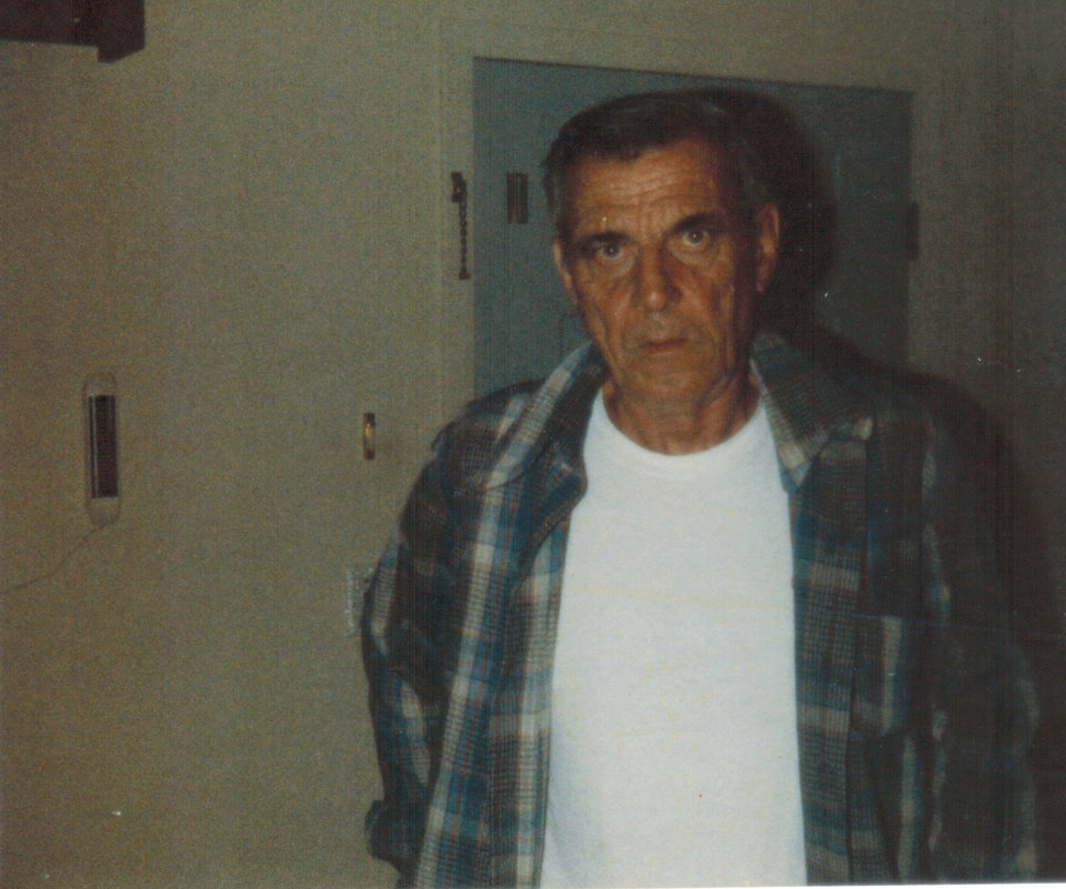 Photo -  Jim's father often wore a T-shirt and a flannel shirt. He always struck me as being defined by the pain of his accident, as if it had leeched him of color and left him gray.