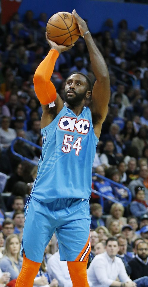 Photo - Oklahoma City's Patrick Patterson (54) shoots during an NBA basketball game between the Oklahoma City Thunder and the Atlanta Hawks at Chesapeake Energy Arena in Oklahoma City, Friday, Nov. 30, 2018. Photo by Nate Billings, The Oklahoman