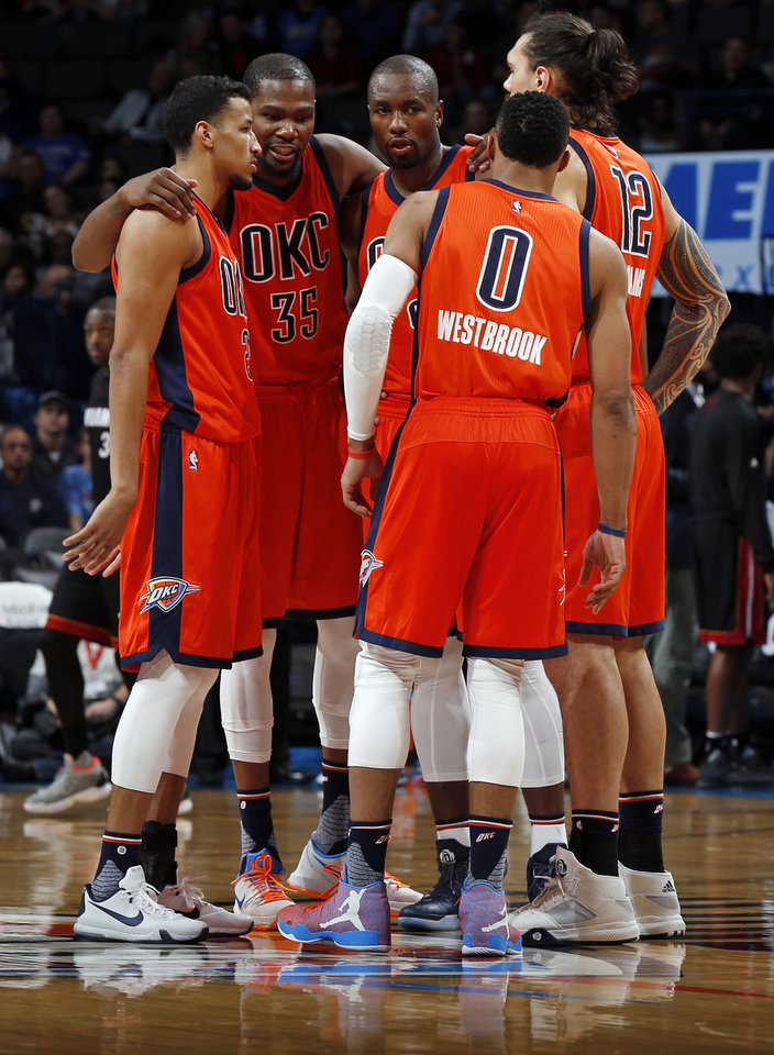 Photo - From left, Oklahoma City's Andre Roberson (21), Kevin Durant (35), Serge Ibaka (9), Russell Westbrook (0) and Steven Adams (12) huddle together during an NBA basketball game between the Oklahoma City Thunder and the Miami Heat at Chesapeake Energy Arena in Oklahoma City, Sunday, Jan. 17, 2016. Oklahoma City won 99-74. Photo by Nate Billings, The Oklahoman