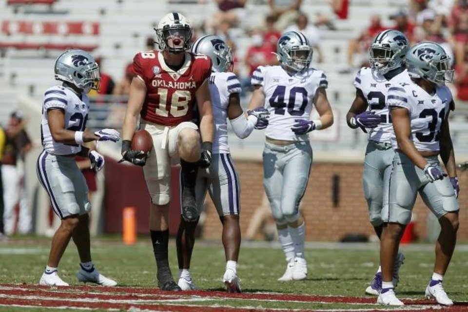 Photo -  Oklahoma's Austin Stogner celebrates after a reception last week against Kansas State. [Bryan Terry/The Oklahoman]