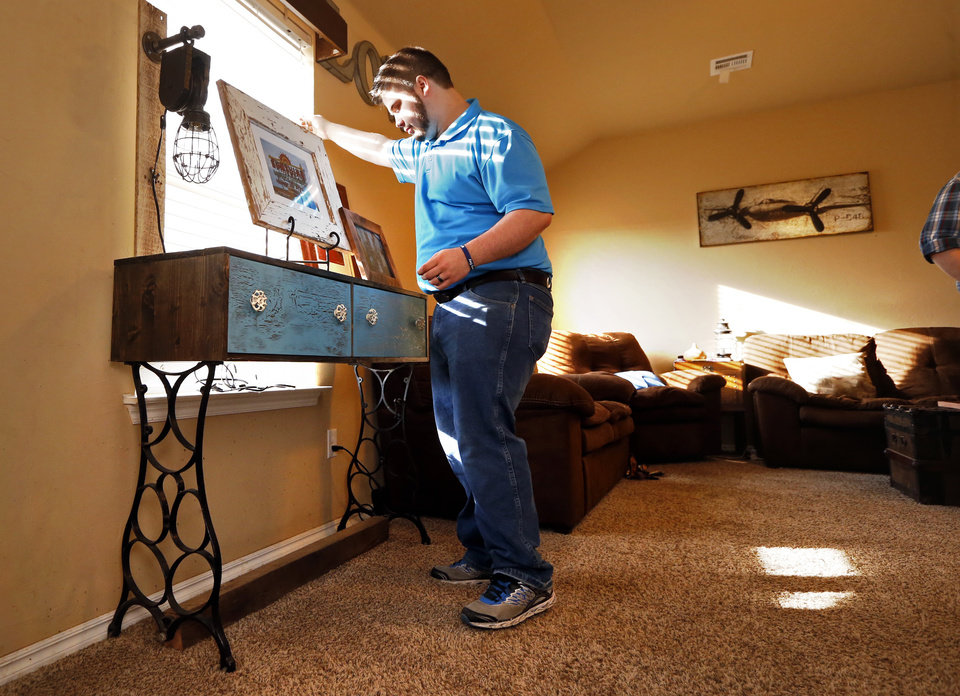 Epic Jake Lowden shows a table made from repurposed material PHOTO BY STEVE SISNEY THE OKLAHOMAN