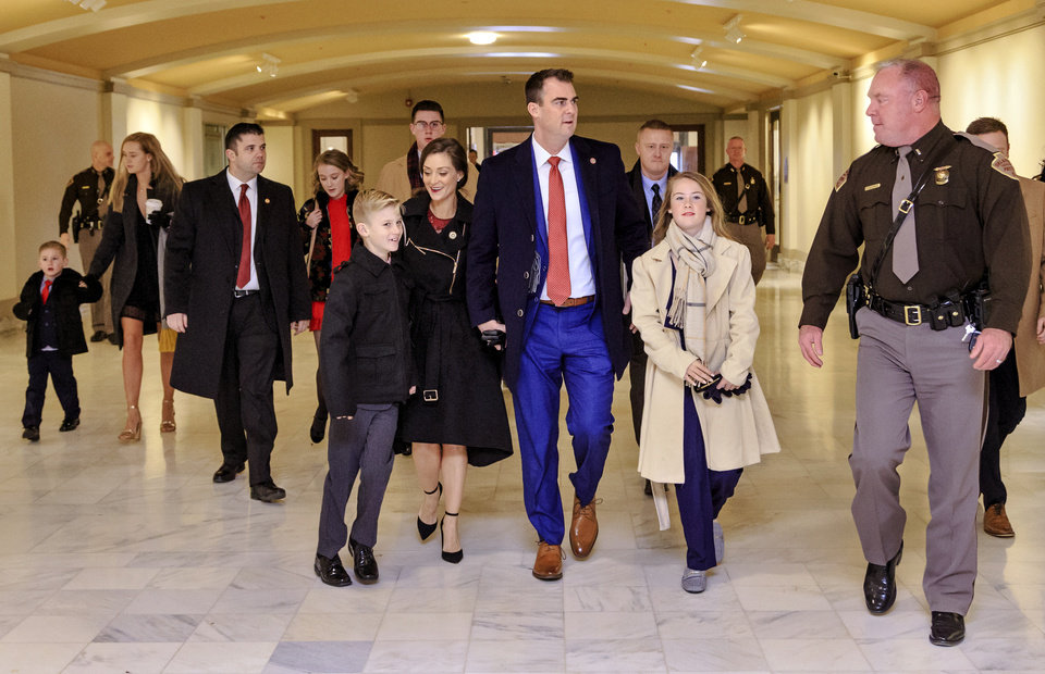 Photo - Gov. elect Kevin Stitt, center, arrives with his family for his inauguration ceremony  at the Oklahoma State Capitol in Oklahoma City, Okla. on Monday, Jan. 14, 2019.  Photo by Chris Landsberger, The Oklahoman
