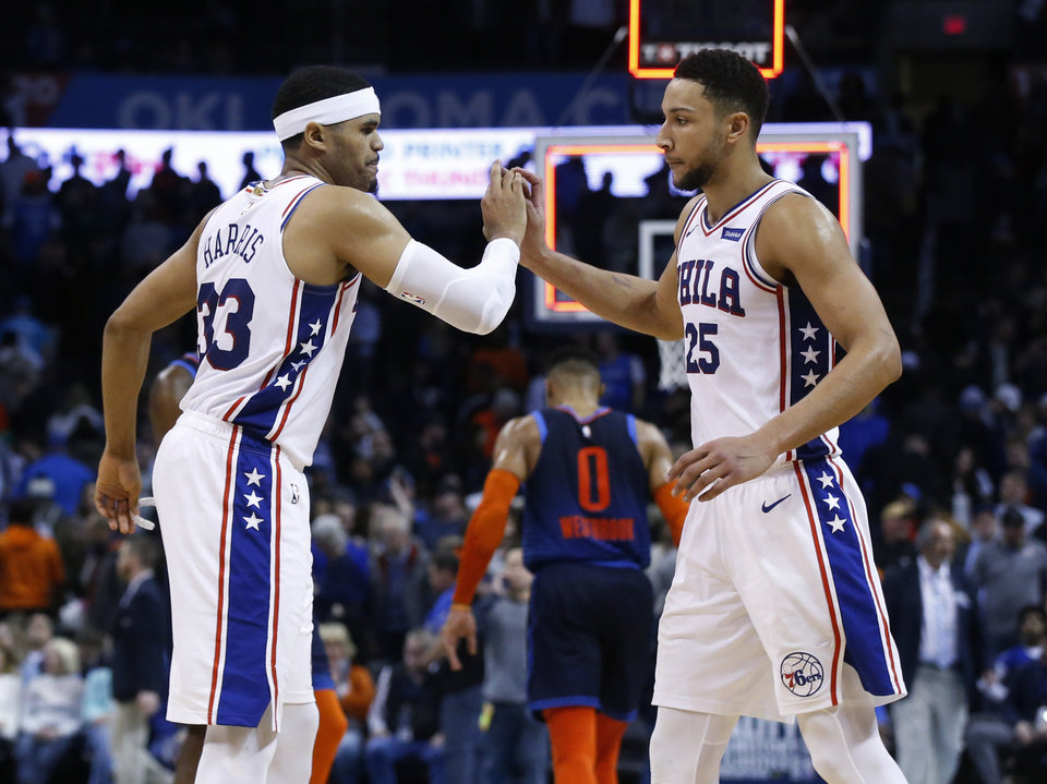 Photo - Philadelphia 76ers' Tobias Harris (33) and Ben Simmons (25) high-five as Oklahoma City Thunder guard Russell Westbrook walks off the court following an NBA basketball game Thursday, Feb. 28, 2019, in Oklahoma City. Philadelphia won 108-104. (AP Photo/Sue Ogrocki)