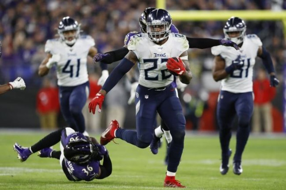 Photo -  After Derrick Henry (22) ran over Baltimore in the divisional round Jan. 11, Ravens defensive coordinator Wink Martindale said the Titans running back is