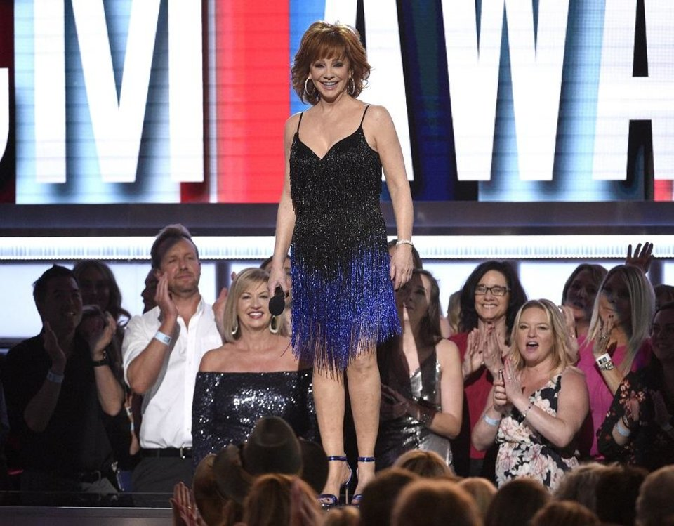 Photo - Host Reba McEntire speaks at the 54th annual Academy of Country Music Awards at the MGM Grand Garden Arena on Sunday, April 7, 2019, in Las Vegas. (Photo by Chris Pizzello/Invision/AP)
