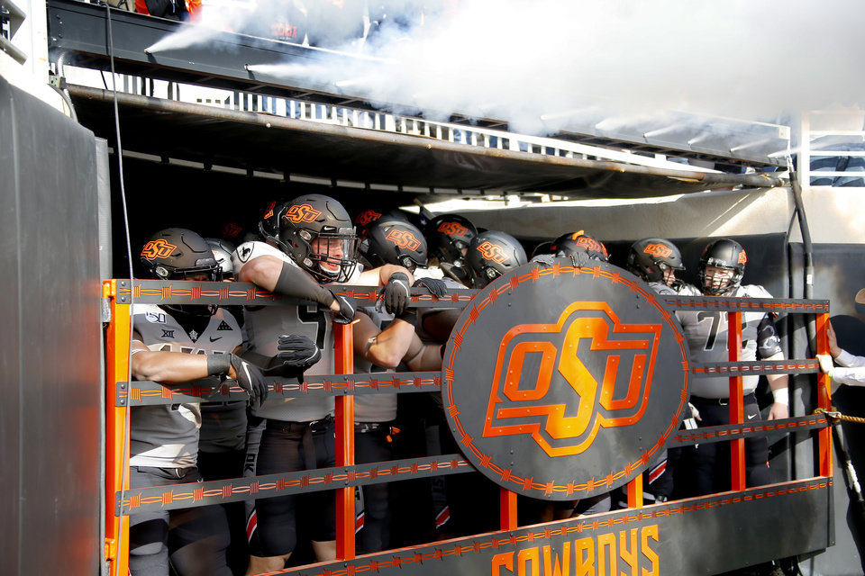 Photo - Oklahoma State players wait to run onto the field before the college football game between the Oklahoma State University Cowboys and the Kansas Jayhawks at Boone Pickens Stadium in Stillwater, Okla., Saturday, Nov. 16, 2019. OSU won 31-13. [Sarah Phipps/The Oklahoman]