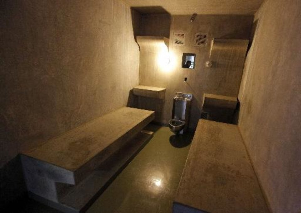 Photo - The inside of cell LL on H Unit's death row at the Oklahoma State Penitentiary in McAlester, Okla., Wednesday, Dec. 7, 2011. Cell LL is where inmates are kept just before their execution.  Nate Billings - THE OKLAHOMAN