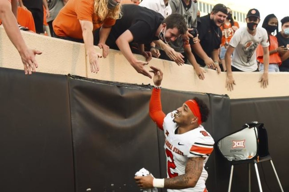 Photo -  Oklahoma State wide receiver Tylan Wallace (2) celebrates with the student section following Oklahoma State's 27-13 win over West Virginia in an NCAA college football game Saturday, Sept. 26, 2020, in Stillwater, Okla. (AP Photo/Brody Schmidt)