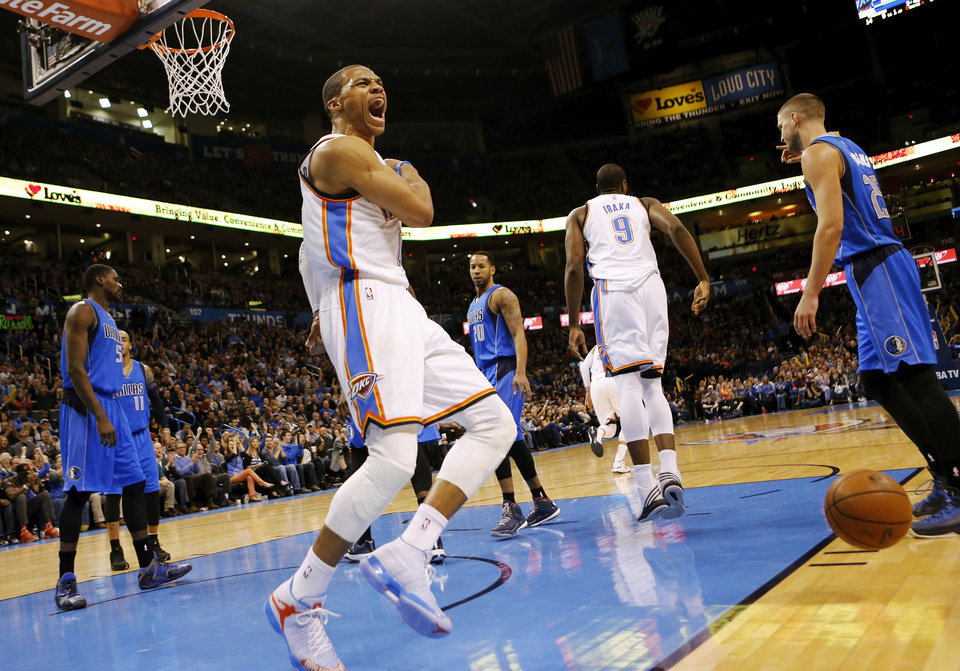 Photo - Oklahoma City's Russell Westbrook (0) reacts after dunking the ball in the first half during an NBA basketball game between the Oklahoma City Thunder and the Dallas Mavericks at Chesapeake Energy Arena in Oklahoma City, Thursday, Feb. 19, 2015. Photo by Nate Billings, The Oklahoman