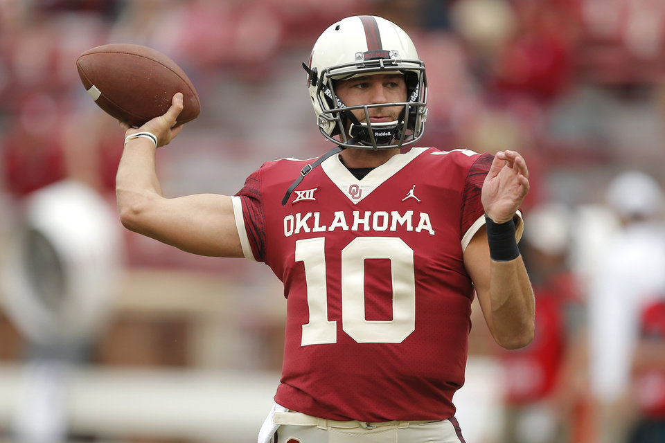 Photo - Oklahoma's Austin Kendall (10) warms up before a college football game between the University of Oklahoma Sooners (OU) and the Baylor Bears at Gaylord Family-Oklahoma Memorial Stadium in Norman, Okla., Saturday, Sept. 29, 2018. Photo by Bryan Terry, The Oklahoman