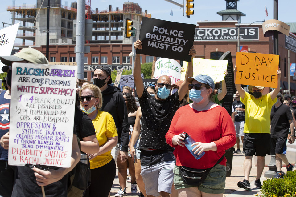 Photo - Protesters march through the streets during a Black Lives Matter OKC Rally in the Bricktown area of Oklahoma City on Saturday, June 6, 2020. Photo by Alonzo Adams for The Oklahoman.