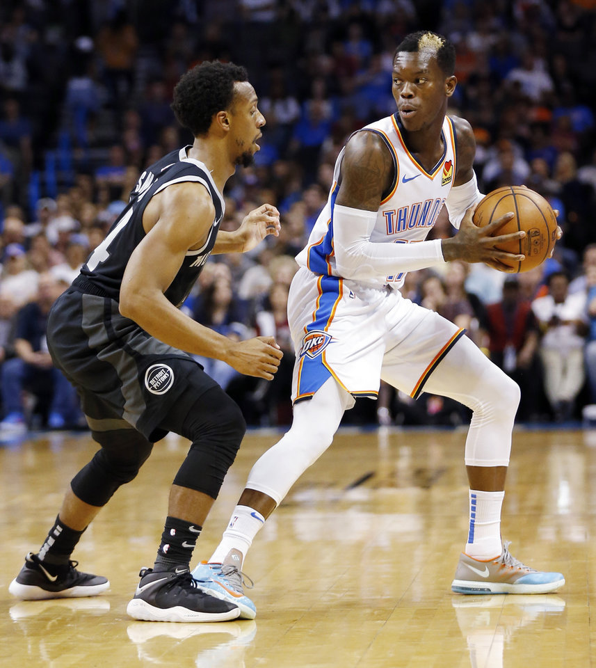 Photo - Oklahoma City's Dennis Schroder (17) holds the ball as Detroit's Ish Smith (14) defends in the first quarter during an NBA basketball game between the Detroit Pistons and the Oklahoma City Thunder at Chesapeake Energy Arena in Oklahoma City, Friday, April 5, 2019. Photo by Nate Billings, The Oklahoman