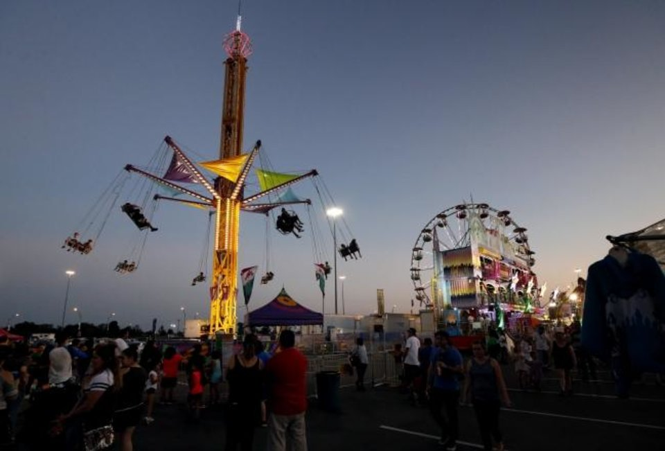 Photo -  Games and rides are seen on the Midway at the Oklahoma State Fair. [The Oklahoman archives]