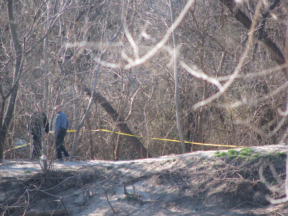 Photo - Officials survey the scene of a plane crash in Oklahoma City today. Photo by Augie Frost