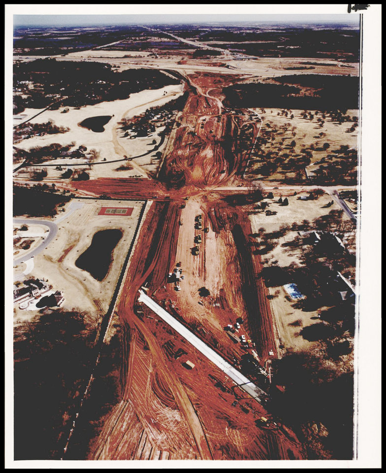 """Photo - HIGHWAYS  CITY  EXPRESSWAYS  PROPOSED OUTERLOOP: UNKNOWN: Caption reads, Earthwork for the John Kilpatrick Turnpike, the long planned """"north outer loop"""" draws an intricate pattern between gracious estates in northeast Oklahoma City. Staff Photo by George R. Wilson. Original Photo 01/10/1990. Published on O-1-23-90."""