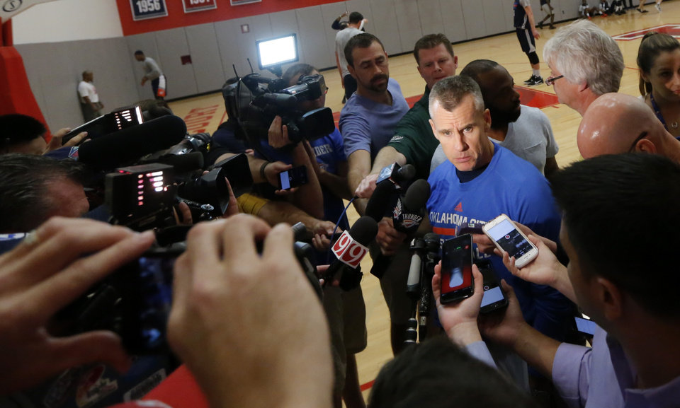 Photo -  Thunder coach Billy Donovan, center, begins the process of making adjustments, both in the regular season and the playoffs, soon after a game ends. [PHOTO BY SARAH PHIPPS, THE OKLAHOMAN]